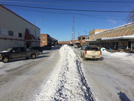 """Snow in Havre is being pushed to the middle of streets where it's then placed on dump trucks and transported to vacant land. """"We haven't had any of our warm Chinook winds come in and get rid of this stuff,"""" said Dave Peterson, Havre's director of Public Works."""