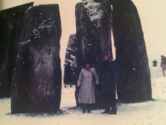 Jim and Georgiann Potts join others wandering though the stones at Stonehenge. This was long ago when there were no ropes restricting access to the monoliths.