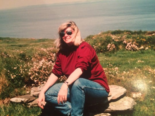 Georgiann seated at the ruins of Tintagel Castle in