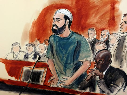 In this courtroom drawing, defendant Ahmad Khan Rahimi