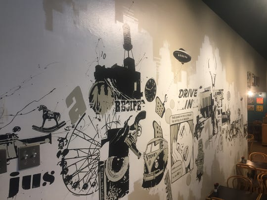 Here's the full wall of art at Steve's on Congress