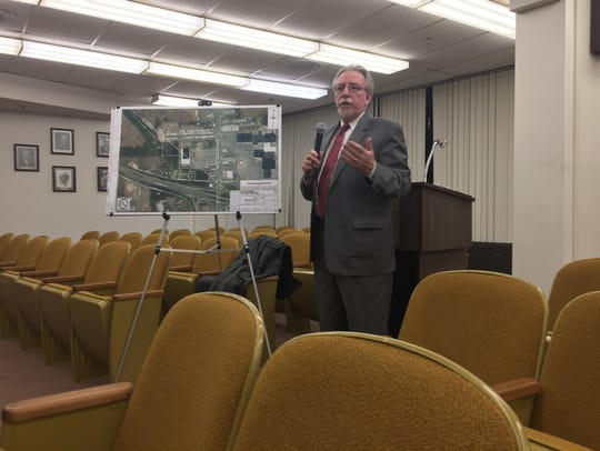 Attorney Rocco Tedesco explains a redevelopment plan