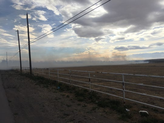 A grass fire on Boyd Drive Feb. 14 created smoke that was carried throughout Carlsbad by the gusting wind in the area.