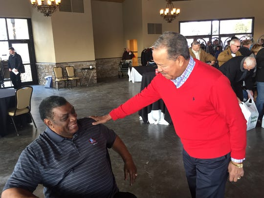 How often do hall of famers meet like this? Football's Dave Robinson, left, and baseball's Juan Marichal exchange well-wishes at York Area Sports Night.