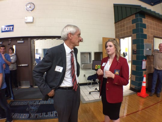 State Superintendent Tony Evers talks with Little Chute