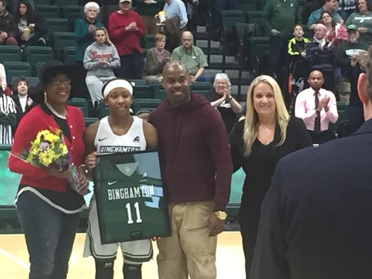 Guard Imani Watkins is flanked by her parents Saturday on Binghamton University's Senior Day before the Bearcats' game against UMass Lowell at the Evens Center. Watkins became the program's all-time leading scorer in the first quarter, surpassing Bess Greenberg.