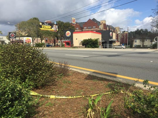 """Police tape remains along Tennessee Street the day after police used a Taser on 20-year-old Aaron Parker in February. He later died at the hospital. Police say he was exhibiting signs of """"excited delirium."""""""