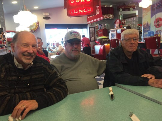 (From left) Larry Kretzmann, Greg Nix and Pete Nix were among those gathered Friday at The Nutcracker to remember Tom Caw.