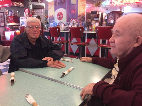 """(From left) Longtime friends and lunch mates Pete Nix and Ernie Moorehead paid tribute to Tom Caw on Friday at The Nutcracker, praising him as a """"straight shooter"""" and devoted family man and husband."""