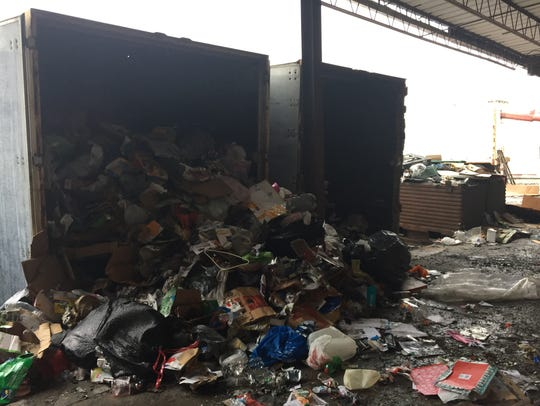 Mixed recyclables are unloaded from the trailers at Transfer Systems & Warehousing.