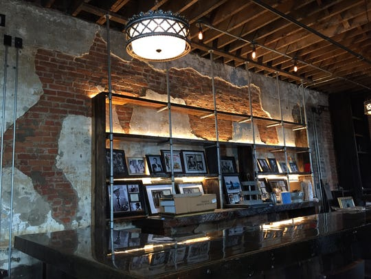 Exposed brick walls frame black-and-white photographs
