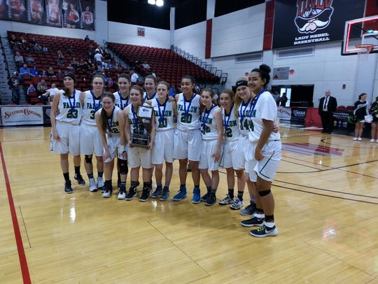 Fallon players hold the trophy after the winning the