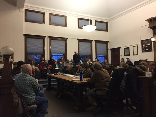 Harlan Rouns, a Lewistown area rancher, speaks about wilderness study areas during a meeting at the Fergus County Courthouse Wednesday evening. The meeting drew more than 130 people.