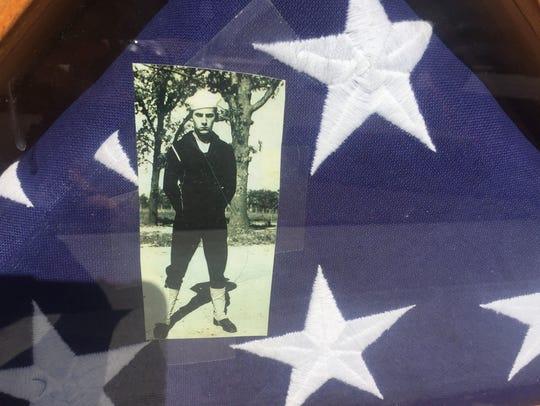 Donna Dewberry found this burial flag and photo near
