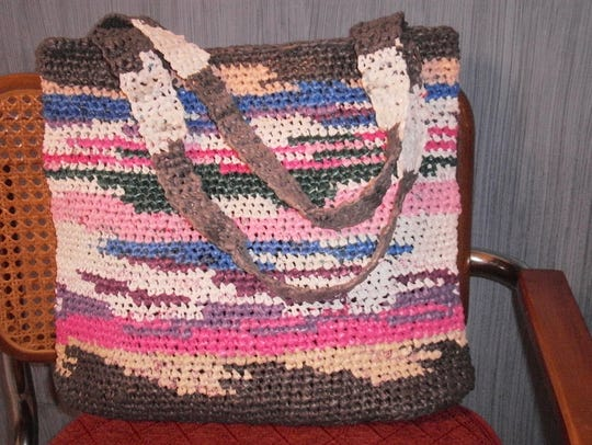 Elaine Ellman creates colorful beach bags and totes using plastic grocery bags.