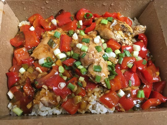 The sweet-and-sour chicken with rice at Blossom in Winooski.