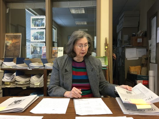Linda Hallmark, vice president of the Henderson County Historical and Genealogical Society, leafs through some of the materials recently donated that led to the society publishing a Confederate soldier's Civil War diary.