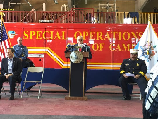 Camden Mayor Frank Moran, flanked by U.S. Rep. Donald Norcross (left) and Camden Fire Chief Michael Harper, talks about city firefighters and Cooper University Hospital EMS personnel who went 'above and beyond' the call of duty.