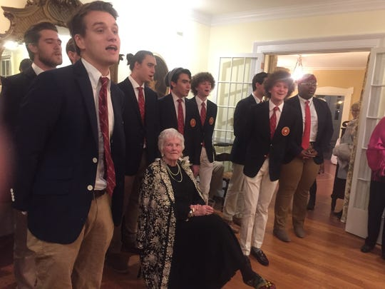 The Denison University Hilltoppers serenade Joanne Woodyard at the Feb. 28 ceremony at the Robbins Hunter Museum in Granville.