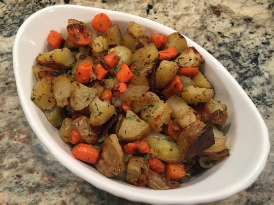 Roasted Carrots, Potatoes and Onions are a simple year-round dish.