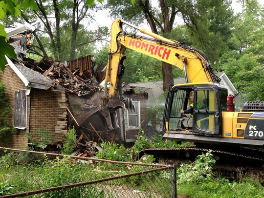 A contracted demolition crew from Detroit-based Homrich