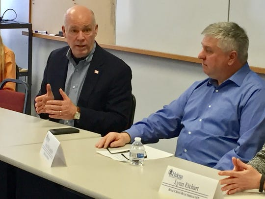 Rep. Greg Gianforte, left, talks Friday at the Helena