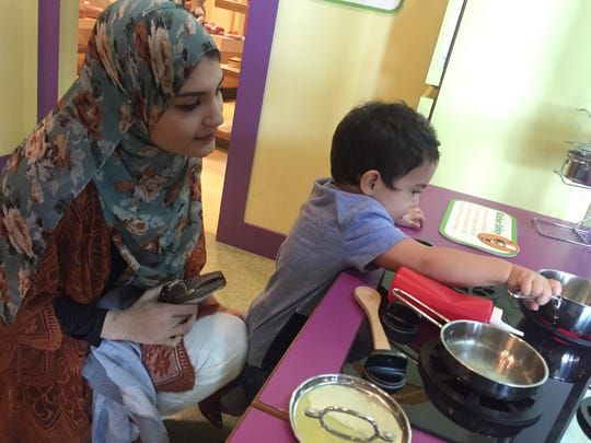 Musa Abdeljaber, 1, plays in Sci-Port's Power of Play Museum March 2 with his mother, Ruwan Alkam, 23.
