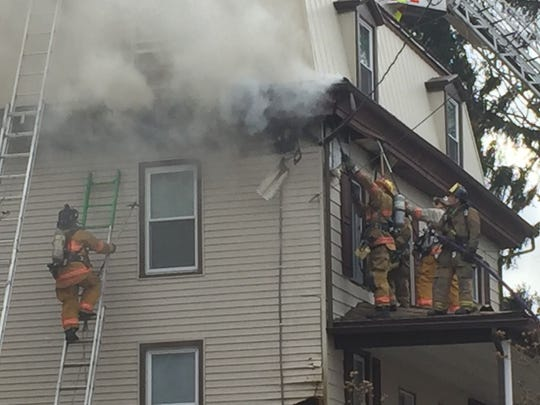 Firefighters battle a blaze at 2196 Walnut Street in North Cornwall Township on Friday afternoon.