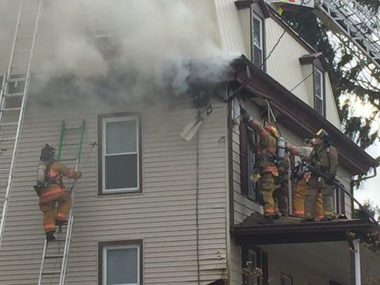Firefighters battle a blaze at 2196 Walnut Street in