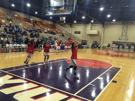 Kennedy players warm up before their game Friday in