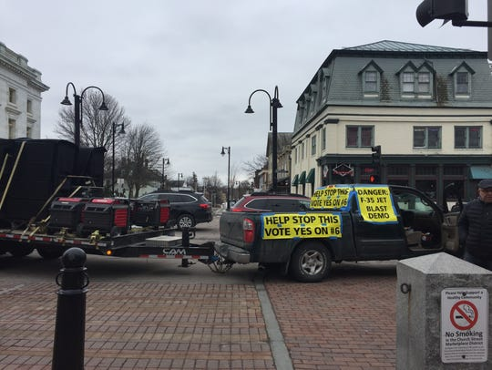 A truck blasts jet noise at Church and Main streets