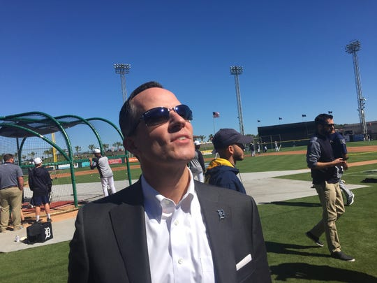 Chris Ilitch looks into the stands at Joker Marchant Stadium before speaking to reporters on Saturday morning.