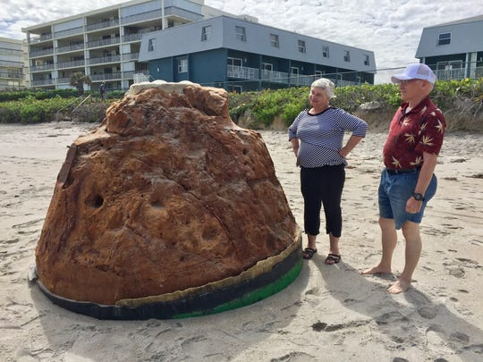 Snowbirds Mary Lou and Dan McFarland of Locust Grove, Virginia, examine the mystery buoy March 2 in South Patrick Shores.