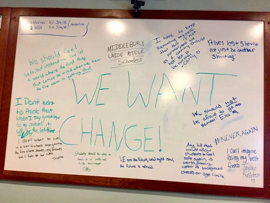 """""""We should feel safe, but instead we live in a world where the first thing that comes to mind when we hear the fire alarm is getting shot,"""" students from Middlebury Union Middle School wrote on a white board in the House Judiciary Committee room at the Statehouse in Montpelier. Photographed March 2, 2018."""