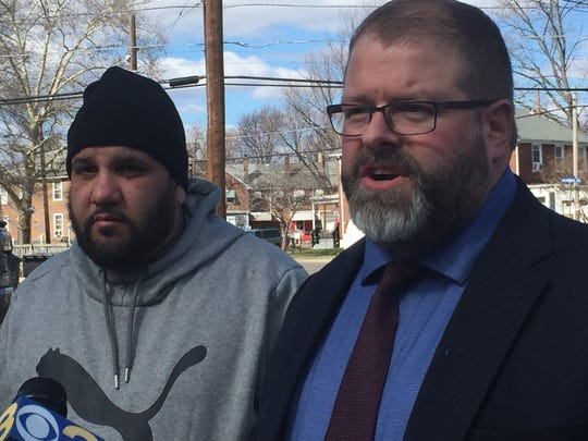 Edward Minguela of Camden and attorney Devon Jacob hold a March 2018 press conference at the scene of an alleged police assault in the Fairview area.