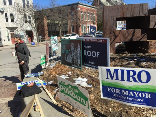 Campaign signs tell the story Tuesday outside the Ward
