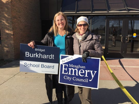 South Burlington School Board incumbent candidate Bridget Burkhardt, left, and City Council incumbent candidate Meaghan Emery greet voters outside Frederick H. Tuttle Middle School on Town Meeting Day 2018.