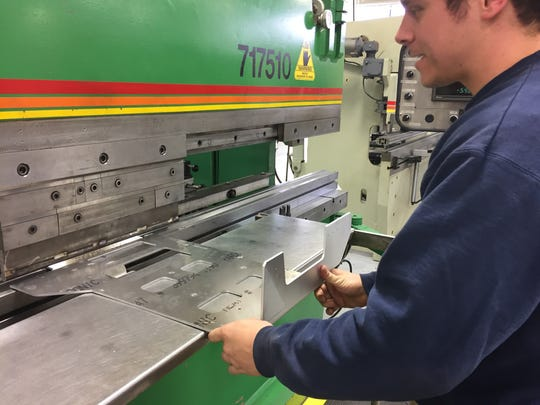 Frank Crisafulli, chief operating officer of Central Metal Fabricators, operates an Acupress press break that's used to bend metal.
