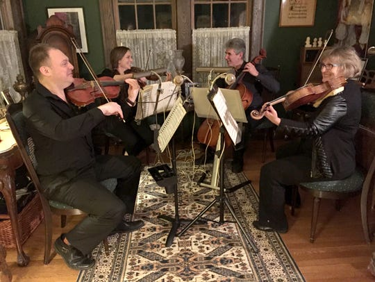 Romanza Music String Quartet with(from left) Mikhail