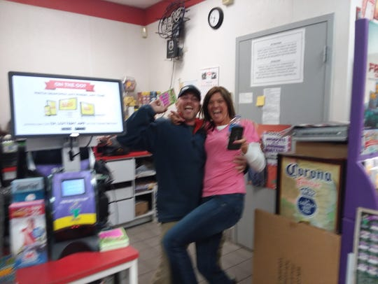 Daniel Patton celebrates with his girlfriend, Paula Gonzalez, who won $75,000 with a scratch-off ticket purchased at the Marathon gas station in Rocky Hill. The photo was taken by a friend of Gonzalez who was at the station filling his car when the big win was revealed.
