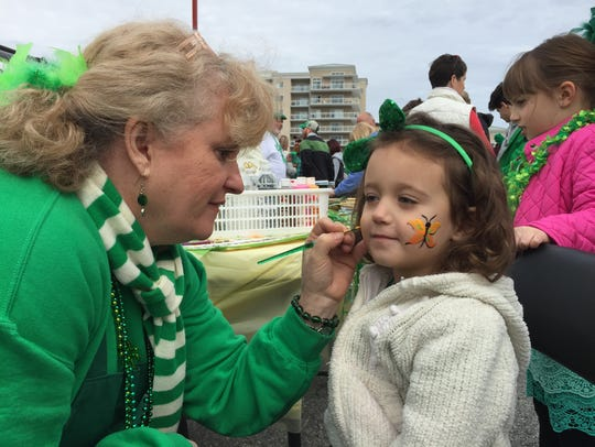 A child has her face painted at the Irish festival