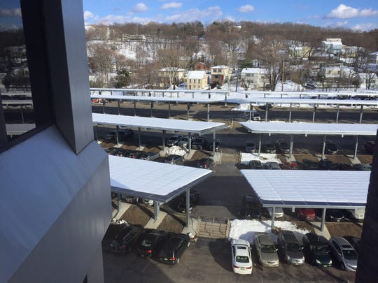 A solar panel canopy project at a corporate office park in Woodland Park shows the type of car-port stands being considered on the central campus of the West Milford school district.