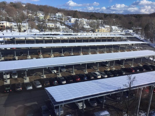 The solar panel canopy project in Woodland Park, here covered in snow, will generate 3.1 million kilowatt hours of energy a year to power office buildings on Garret Mountain.