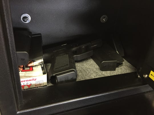 Loaded Glock 19 guns are kept secured in safes that