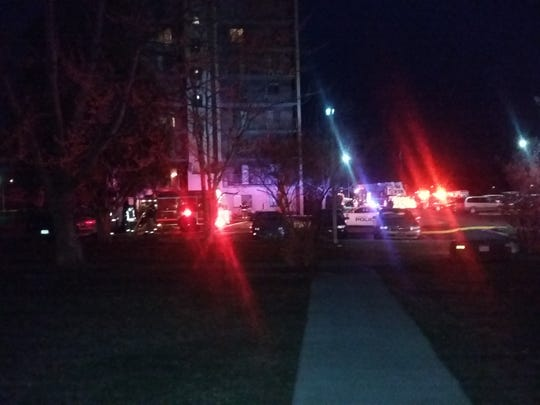 Emergency crews surround Grandview Tower Apartments while responding to a structure fire Friday, March 9, 2018.
