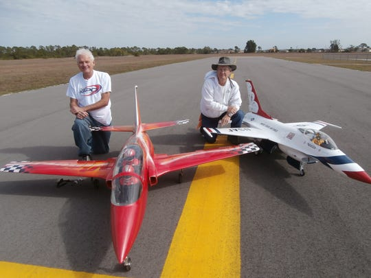 Pictured are Cape Coral R/Sea Hawks Club members Dan Sharp (left) next to his 95-inch-wingspan CARF Viper jet and Dave King with his 65-inch-wingspan F-16 Thunderbird SKY Master fighter jet at Seahawk Park.