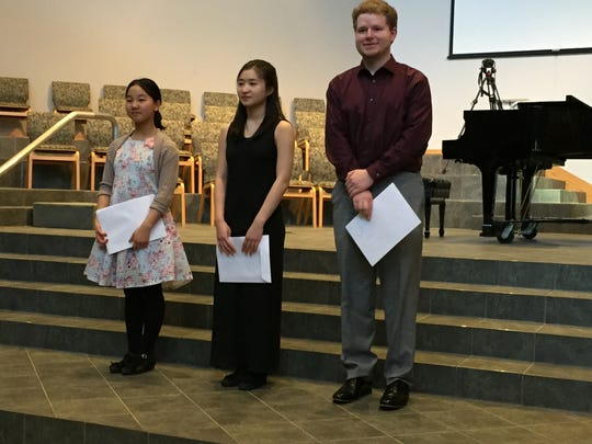 Special award winners are Salem Wang, Susie Lee and Owen Hobson. Not pictured is Jubilee Wang.
