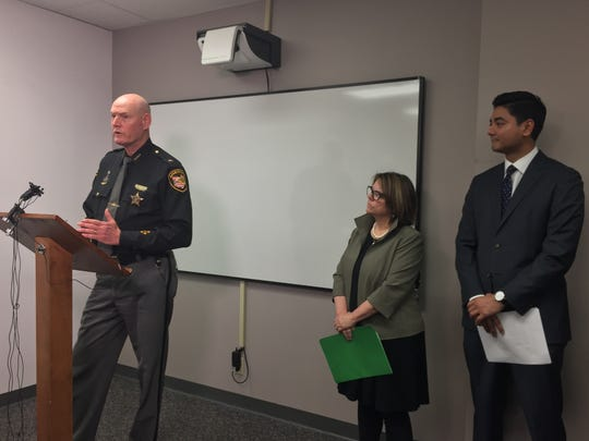 Hamilton County Sheriff Jim Neil, Judge Amy Searcy and Hamilton County Clerk of Courts Aftab Pureval announce the debut of a text-messaging program for survivors of domestic violence.