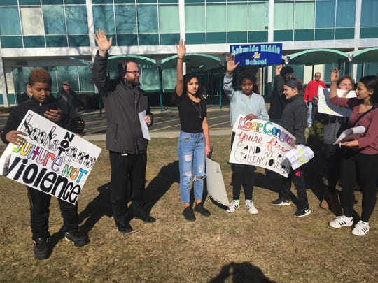 Lakeside Middle School on North Sharp Street in Millville held a brief walkout event at 10 a.m. Wednesday on the front lawn. Seventh grader Jordan Webster (center, jeans) organized the walkout. Principal Spike Cook stands to her right.