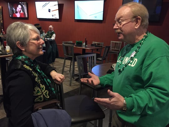 United Way director Doug Dolph visits with former director